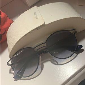 Iike new authentic Prada sunglasses with case
